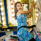 A happy girl riding the carousel