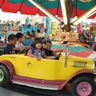 Children riding the roadster hot rods