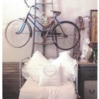 Urban Farm House - Bicycle Hanging above chair