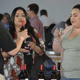 Women attending the wine tasting during the Salinas Valley Fair Grand Tasting