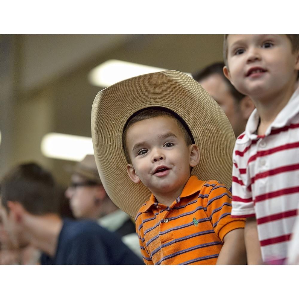 little boys, cowboy hat, having fun