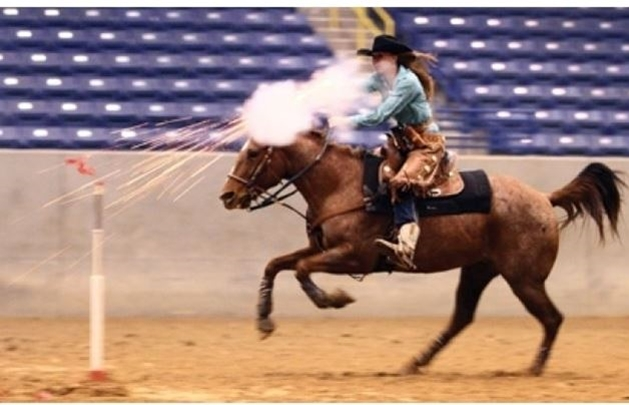 cowgirl shooting gun horse back