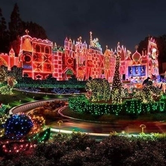 Exterior of Its a Small Word Ride at Disneyland at night