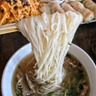 Noodles, fries, and spring rolls at Sup Noodle Bar in Buena Park