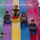 Children riding down a slide at the OC Fair & Event Center