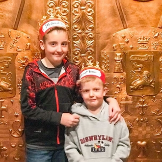 Two boys with paper crowns at Medieval Times in Buena Park, CA