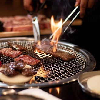 Meat on grill at Saemaeul Restaurant in Buena Park, CA