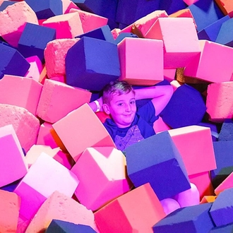 Boy in foam pit at Big Air in Buena Park, CA