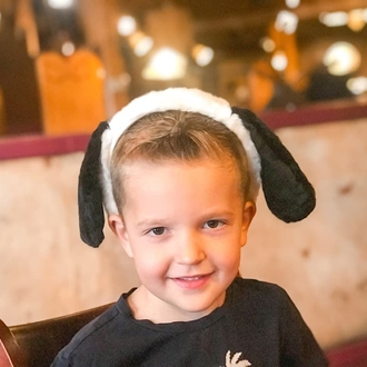 Boy with Snoopy ears at Amber Waves restaurant in Buena Park, CA