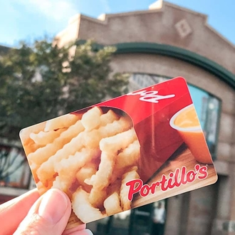 Portillo's gift card in front of building in Buena Park, CA