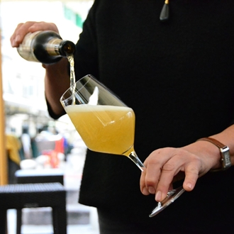 Server pouring a drink