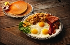 Pancakes, eggs, hash browns, bacon, ham at Black Bear Diner in Buena Park