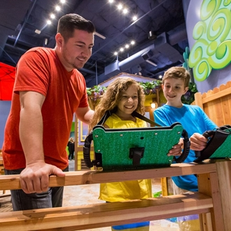 Father, daughter, and son with ipads at Discovery Cube