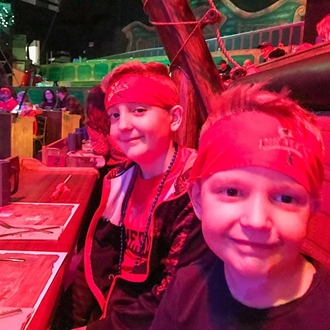 Two boys with bandannas at Pirates Dinner Adventure in Buena Park, CA
