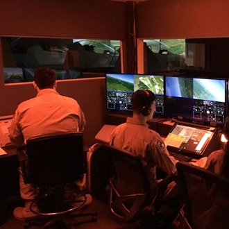 Two people in the command room at Flight Deck