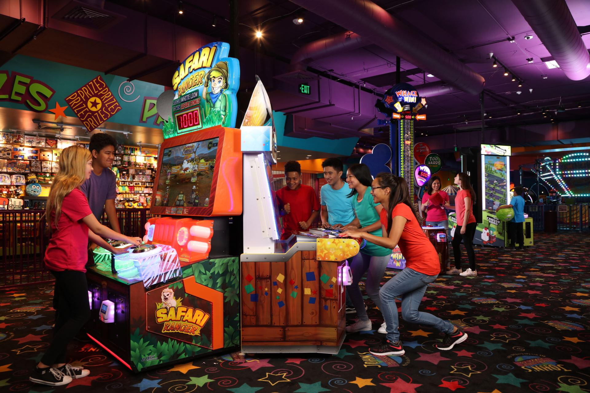 Family playing arcade games at John's Incredible Pizza in Buena Park, CA