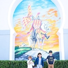 Children in front of mural at Medieval Times in Buena Park, CA