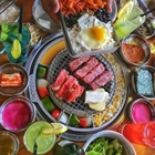 Variety of food at Kang Ho Dong in Buena Park, CA.