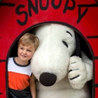 Child and Snoppy in dog house at Knott's Berry Farm in Buena Park, CA