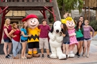 Teens with Charlie, Snoopy, and Sally at Knott's Berry Farm in Buena Park, CA