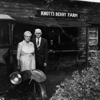 Mr. and Mrs. Knott in front of stand at Knott's Berry Farm in Buena Park