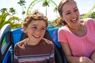 Mother and son on Coastrider ride at Knott's Berry Farm in Buena Park, CA