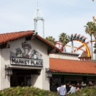 Marketplace with silver bullet and supreme scream in the background at Knott's Berry Farm in Buena Park