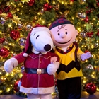 Charlie and snoopy in front of Christmas tree at Knott's Berry Farm in Buena Park