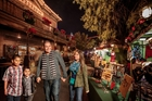 Family looking at craft table at Knott's Merry Farm in Buena Park, CA