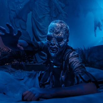 Zombie reaching from grave at Knott's Scary Farm in Buena Park