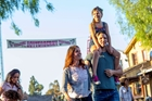 Woman with girl on dads shoulder at Knott's Berry Farm in Buena Park, CA
