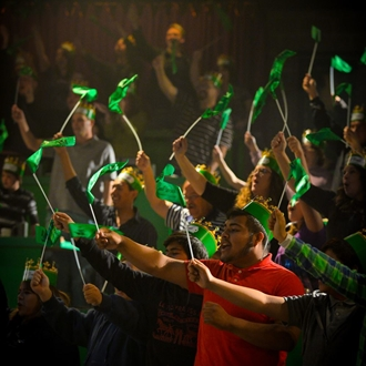 Audience waving green flags at Medieval Times in Buena Park, CA