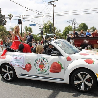 Pageant princess riding in car at Strawberry Festival in Garden Grove