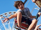 Boy on swing ride at OC Fair