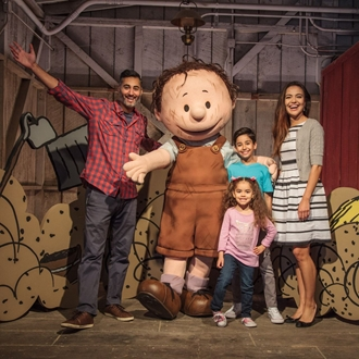Family with pig pen at Knott's Berry Farm in Buena Park, CA