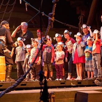 Children at Pirates Dinner Adventure in Buena Park, CA.