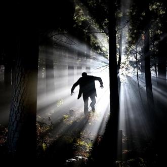 Frankenstein running through a dark forest