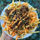 Fries with cheese and meat at SUP Noodle Bar in Buena Park, CA