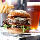 Hamburger, fries, and beer at Fuddruckers in Buena Park, CA