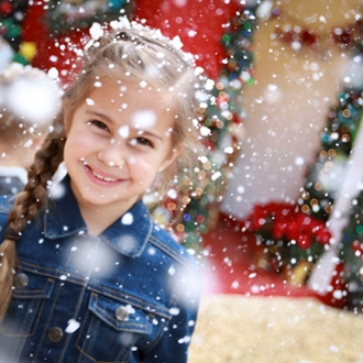 Girl play in snow at Winter Fantasy Sawdust Festival