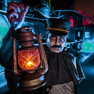 Man holding lantern at Knott's Scary Farm in Buena Park, CA