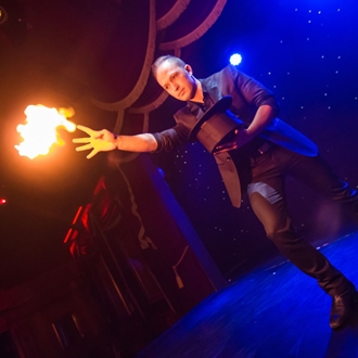 Magician with fire on stage at Teatro Martini in Buena Park