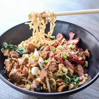 Noodles, meat, and vegetables in a bowl at Uncle Fung in Buena Park