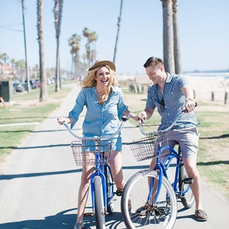 Couple riding bikes from Bargain Bike Rentals