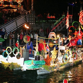 Boats in Christmas decorations at the Newport Boat Parade