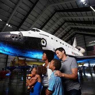 Family looking at a space shuttle at the California Science Center