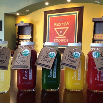 Red, green, and yellow cold pressed juices from Coffee Stop in Buena Park