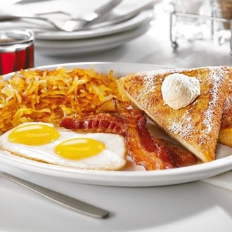 French toast, eggs, bacon, hash browns on a plate at Denny's