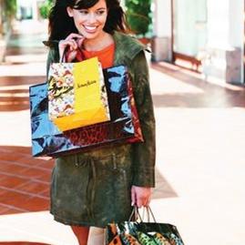 Woman caring shopping bags at Fashion Island