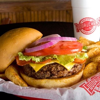 Burger, fries, and a cup with Fuddruckers logo at Fuddruckers in Buena Park